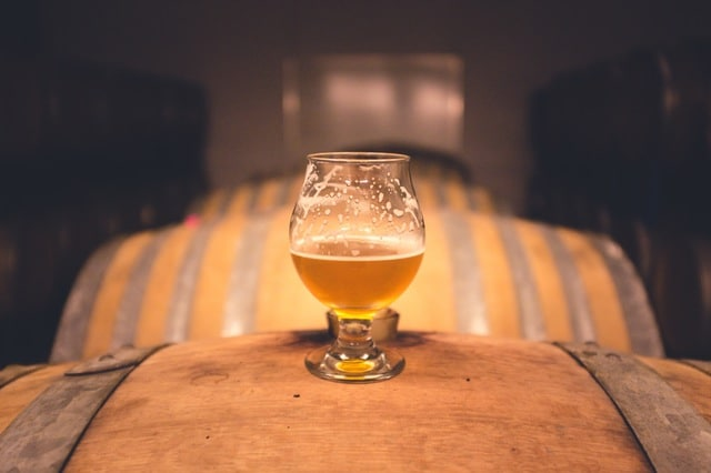 Lonely beer glass on barrel